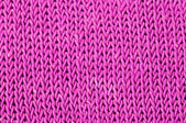 Pink knitted fabric background — Stock Photo