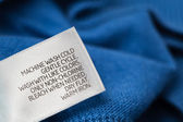 Clothing label with laundry care instructions — Stock Photo