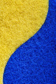 Sponge texture blue and yellow — Stock Photo