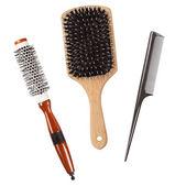 Tre professionella hårborstar isolerade — Stockfoto