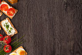 Tasty canapes food border background — Stock Photo