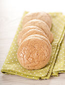 Stack of almond cookies on table — Stockfoto