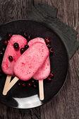 Strawberry popslice icecream on dark background — Stock Photo