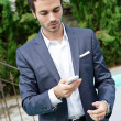 Young business man with phone — Stock Photo #12705698
