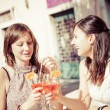 Two Young Women Cheering with Cold Drinks — Stock Photo