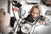 Child rogue riding a motorcycle — Stock Photo