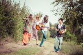 Hippie Group Dancing in the Countryside — Stock Photo