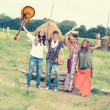 Hippie Group Dancing in the Countryside — Stock Photo #12716130