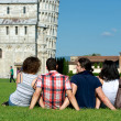 Four Friends on Vacation Visiting Pisa — Stock Photo #12758664