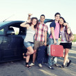 Four Friends Ready to Leave For Vacation — Stock Photo #12758744