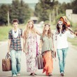 Stock Photo: Hippie Group Hitchhiking on a Countryside Road