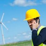 Engineers giving Handshake in a Wind Turbine Power Station — Stock Photo #12857416