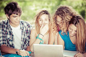 Group of young student using laptop outdoor,Italy — Stock Photo