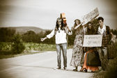 Hippie Group Hitchhiking on a Countryside Road — Stock Photo