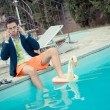 Funny Young Businessman next to the Pool — Stock Photo