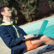Funny Young Businessman next to the Pool — Stock Photo #14052495