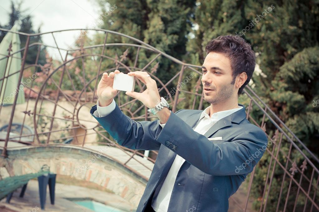 Young Businessman Taking Photos with Mobile, Italy — Stock Photo #14052202