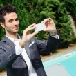 Young Businessman Taking Photos with Mobile — Stock Photo