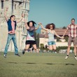Group of Friends Jumping with Pisa Leaning Tower on Background — Stock Photo #15718053