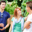 Portrait of happy teens  in the park at summer — Stock Photo