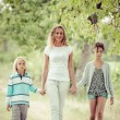 Beautiful Young Woman with Two Children Outside - ストック写真