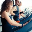 Running on treadmill in gym or fitness club - - Stock Photo