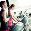 Stock Photo: Running on treadmill in gym or fitness club