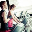 Running on treadmill in gym or fitness club — Stock Photo #15717145