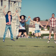 Group of Friends Jumping with Pisa Leaning Tower on Background — Stock Photo