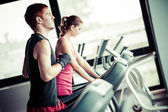 Running on treadmill in gym or fitness club — Stock Photo
