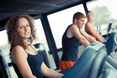 Running on treadmill in gym or fitness club - — Stock Photo