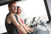 Running on treadmill in gym or fitness club - group of women and — Stock Photo