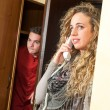 Porter eavesdropping a girl at the telephone — Stock Photo