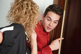 Porter and hotel maid eavesdropping at the door — Stock Photo
