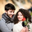 Young couple with rose, outdoors — Stock Photo #19384907