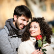 Young couple with rose, outdoors — Stock Photo #19384929