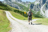 Man in front of crossroads in the mountain — Stock Photo