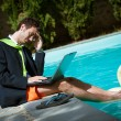 Funny Young Businessman with SwimmingTrunks next to the Pool — Stock Photo #20392549