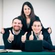 Manager and his team with thumbs up in the office — Stock Photo