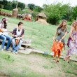 Stock Photo: Hippie Group Dancing in the Countryside
