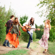 Hippie Group Dancing in the Countryside — Stock Photo #21681399