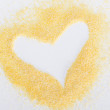 White heart in flour - Stock Photo