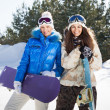 Two smiling girls with snowboards — Stock Photo #18713173