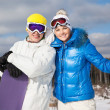 Foto Stock: Couple with snowboards in their hands
