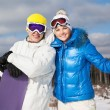 Stock Photo: Couple with snowboards in their hands