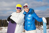 Couple with snowboards in their hands — Stock Photo