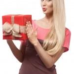 Blonde girl holding gift box — Stock Photo