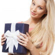 Blonde girl holding gift box — Stock Photo