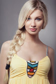 Blonde young woman with braid hairdo — Stock Photo