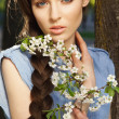 Stock Photo: Portrait of beautiful girl with flowers